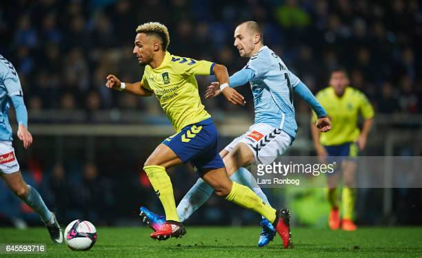 Hany Mukhtar of Brondby IF and Sakari Mattila of Sonderjyske compete for the ball during the Danish Alka Superliga match match between Sonderjyske...