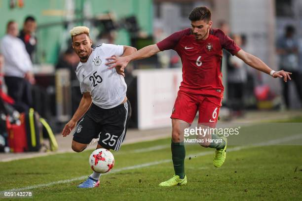Hany Mukhtar of Germany and Ruben Neves of Portugal battle for the ball during the U21 International Friendly match between Germany U21 and Portugal...
