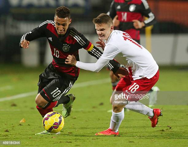 Hany Mukhtar of Germany battles for the ball with Hubert Matynia of Poland during the U20 international friendly match between Germany and Poland at...