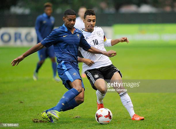Hany Mukhtar of Germany battles for the ball with Raphael Diarra of France during a friendly match between U19 France and U19 Germany at the Didier...