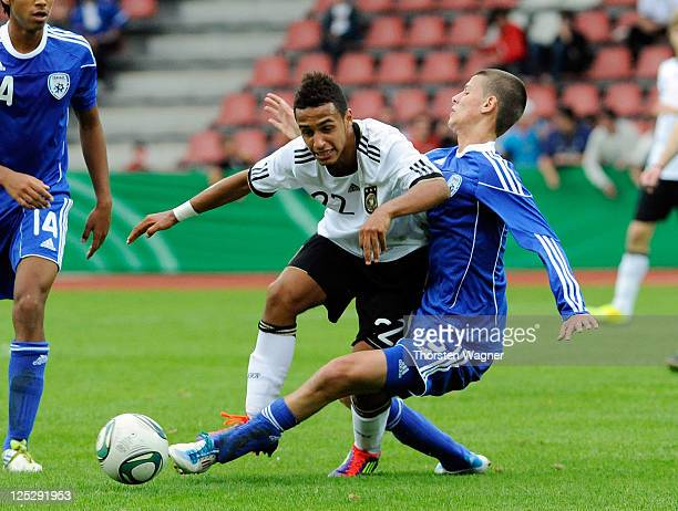 Hany Mukhtar of Germany battles for the ball with Sean Goldbear of Israel during the DFB U17 Four Nations Cup match between Germany and Israel at Aue...
