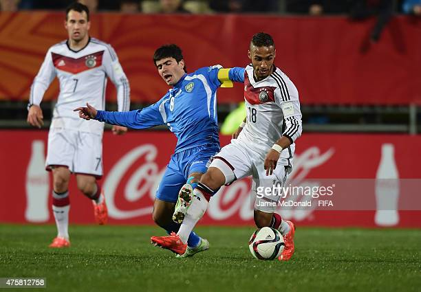 Hany Mukhtar of Germany battles with Javokhir Sokhibov of Uzbekistan during the FIFA U20 World Cup New Zealand 2015 Group F match between Germany and...