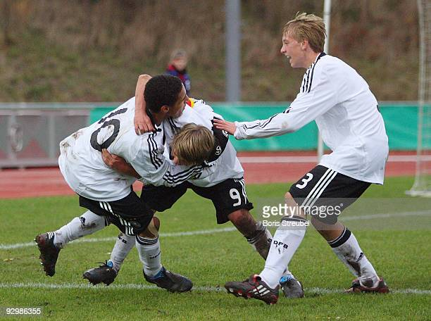 Hany Mukhtar of Germany celebrates the second goal with his team mates Lukas Goettmann and Nico Brandenburger during the U15 International Friendly...