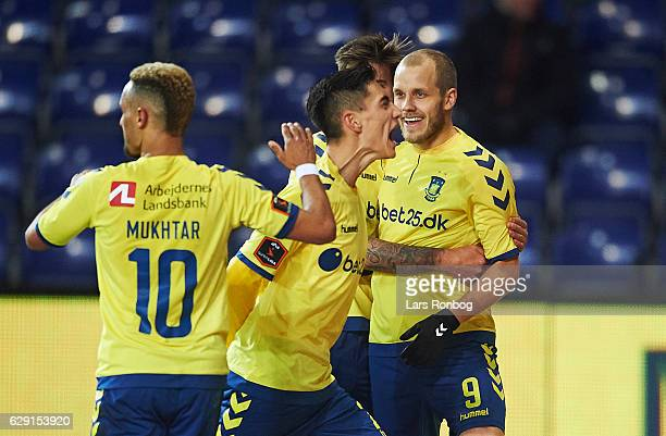 Hany Mukhtar Svenn Crone and Teemu Pukki of Brondby IF celebrate after scoring their second goal during the Danish Alka Superliga match between...