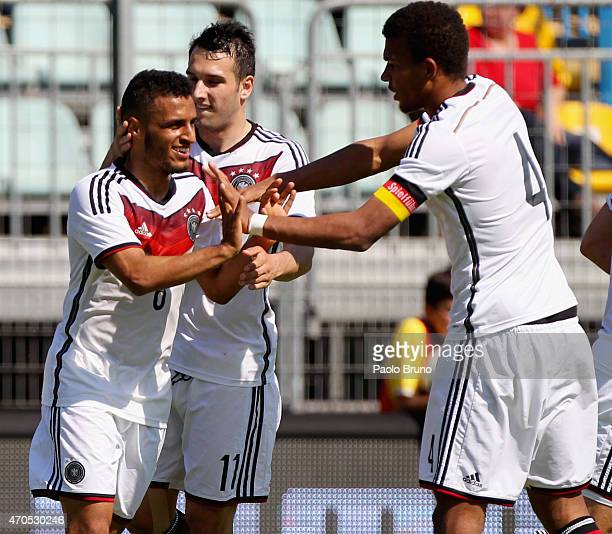 Hany Mukhtar with his teammates of Germany celebrate after scoring the opening goal during the 4 Nations Tournament match between Italy U20 and...