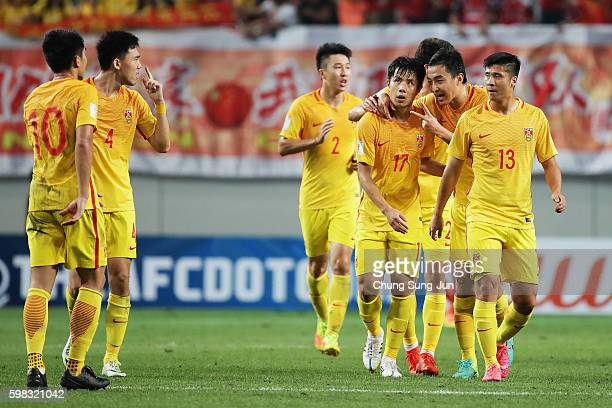 Hao Junmin of China celebrates scoring his team's second goal with his team mates during the 2018 FIFA World Cup Qualifier Final Round Group A match...
