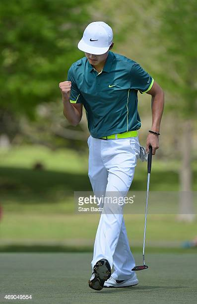 Hao Tong Li of China reacts to his putt on the third hole during the final round of the Webcom Tour Chitimacha Louisiana Open presented by NACHER at...