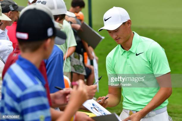 Hao Tong Li of China signs autographs for fans during a practice round prior to the 2017 PGA Championship at Quail Hollow Club on August 9 2017 in...