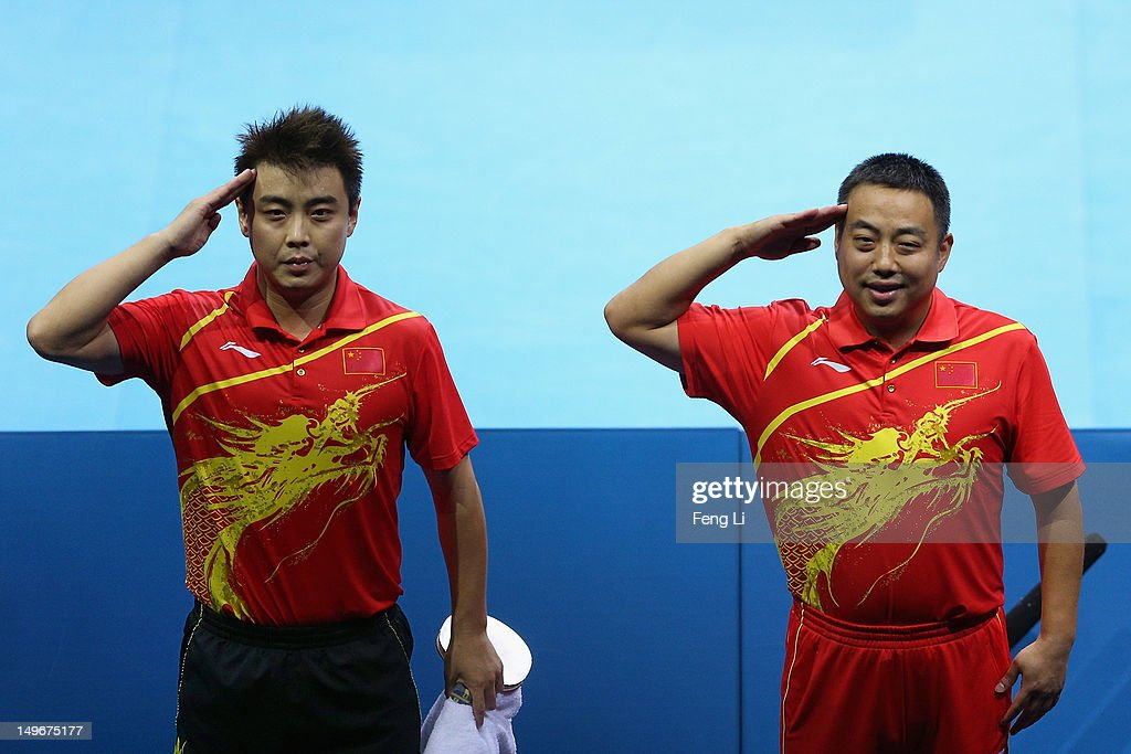 Hao Wang of China and his coach Guoliang Liu celebrate winning against Chih-Yuan Chuang of Chinese Taipei after Men's Singles Table Tennis semifinal match on Day 6 of the London 2012 Olympic Games at ExCeL on August 2, 2012 in London, England.