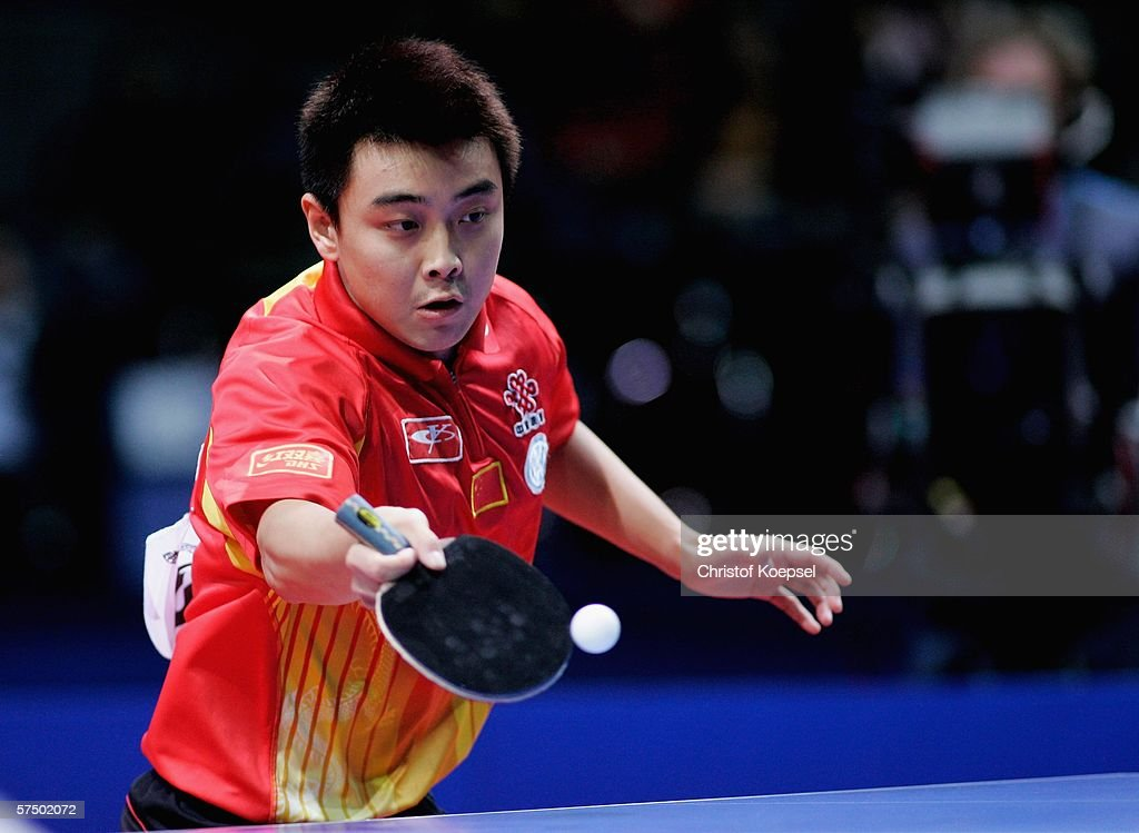 Hao Wang of China plays a forehand against Sang Eun Oh of South Korea during the men's final at the last day of the Liebherr Team Table Tennis...