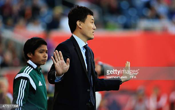 Hao Wei of China looks on after interferring with play during the FIFA Women's World Cup 2015 group A match between China PR and New Zealand at...