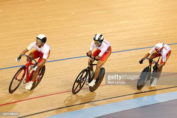 Hao Xie Xiaofei Ji and Xinyang Liu of China compete during the Mixed C1 to 5 Cycling Team Sprint finals on day 4 of the London 2012 Paralympic Games...