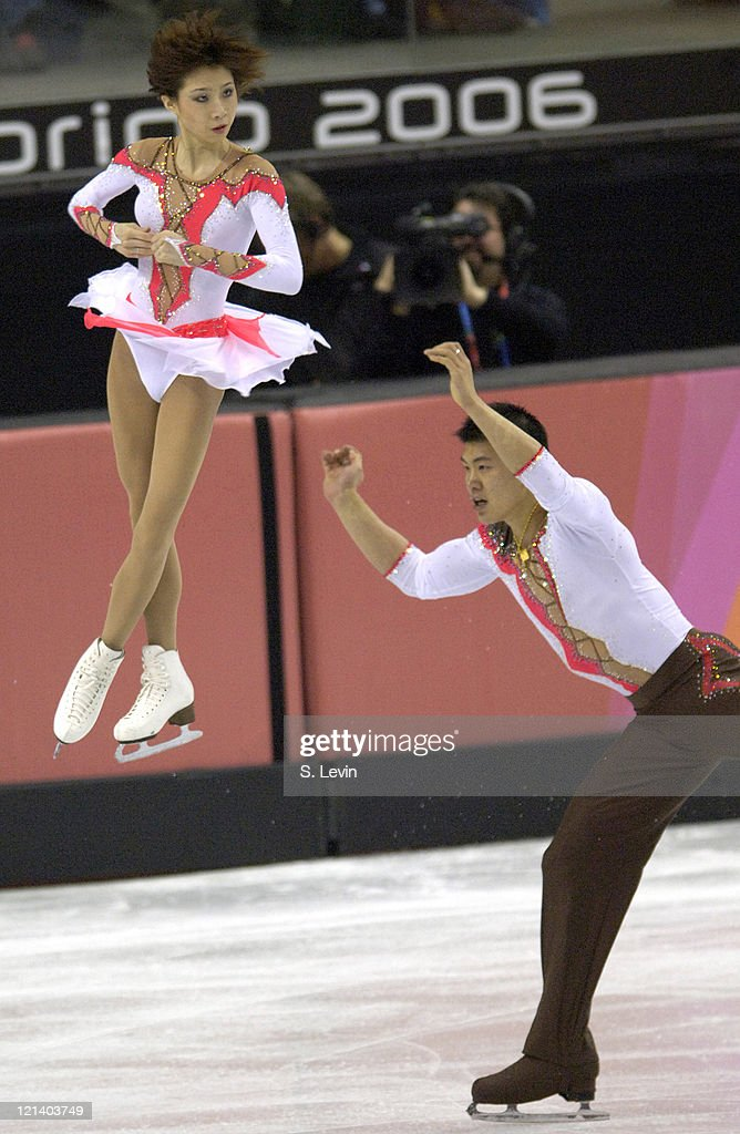 Hao Zhang and <a gi-track='captionPersonalityLinkClicked' href=/galleries/search?phrase=Dan+Zhang&family=editorial&specificpeople=813902 ng-click='$event.stopPropagation()'>Dan Zhang</a> of China earn a silver in the Pairs Free Skate Program at the Palavela skating venue on February 13, 2006 in Torino, Italy.