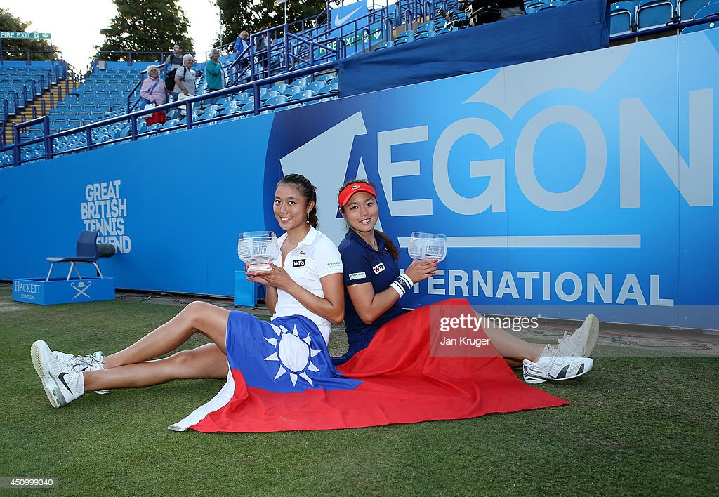 HaoChing and YungJan Chan of Chinese Taipei pose with the trophy after beating Martina Hingis of Switzerland and Flavia Pennetta of Italy during...