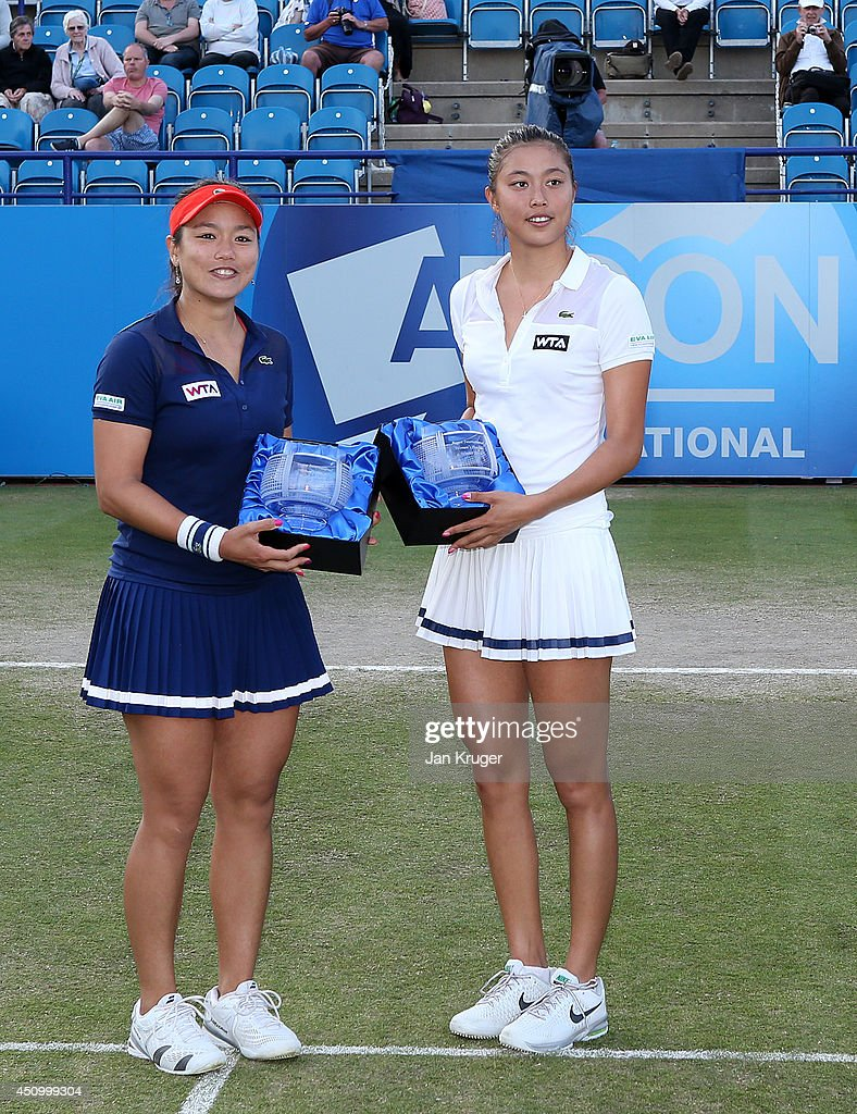 HaoChing and YungJan Chan of Chinese Taipei poses with the trophy after beating Martina Hingis of Switzerland and Flavia Pennetta of Italy during...