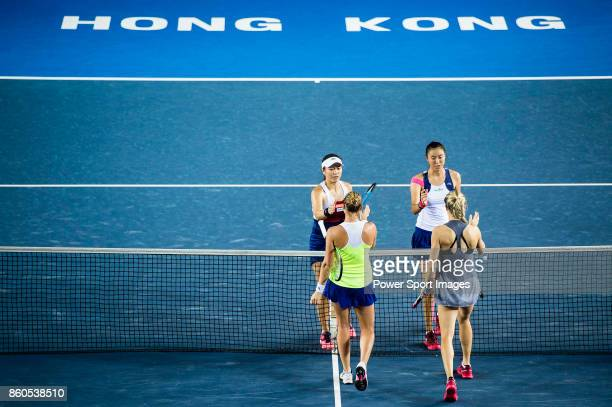 HaoChing Chan and YungJan Chan of Taiwan are congratulated by Eugenie Bouchard of Canada and Shelby Rogers of USA during the Prudential Hong Kong...