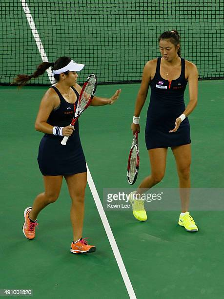 HaoChing Chan of Chinese Taipei and YungJan Chan of Chinese Taipei in action againt Martina Hingis of Switzerland and Sania Mirza of India during the...