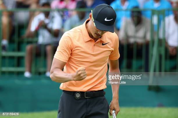 Haotong Li of China celebrates a putt on the 16th green during the final round of the Nedbank Golf Challenge at Gary Player CC on November 12 2017 in...