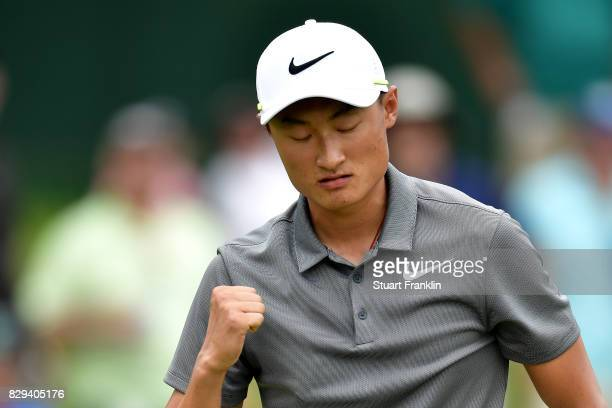 Haotong Li of China celebrates his putt on the 15th hole during the first round of the 2017 PGA Championship at Quail Hollow Club on August 10 2017...