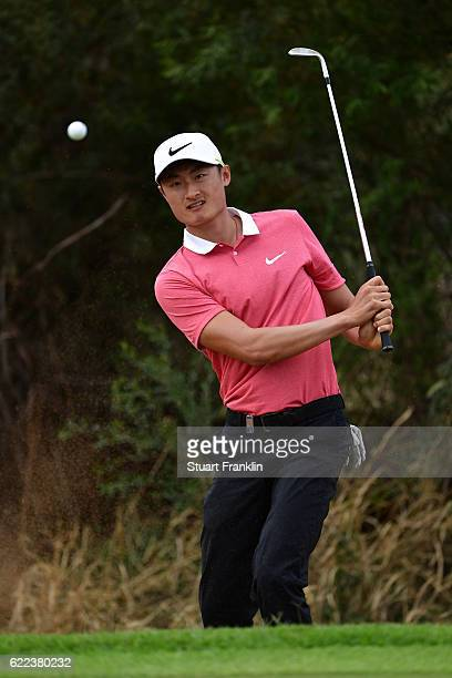 Haotong Li of China chips during day two of the Nedbank Golf Challenge at Gary Player CC on November 11 2016 in Sun City South Africa