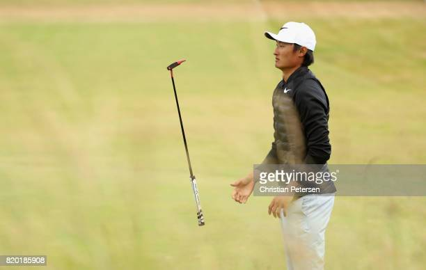 Haotong Li of China flips his club during the second round of the 146th Open Championship at Royal Birkdale on July 21 2017 in Southport England