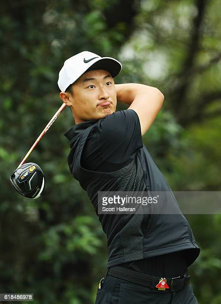 Haotong Li of China hits a tee shot on the 11th hole during the first round of the WGC HSBC Champions at the Sheshan International Golf Club on...