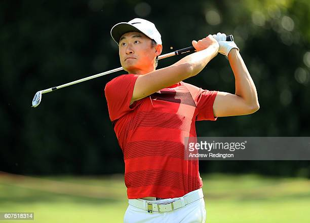 Haotong Li of China hits his second shot on the 18th hole during the fourth round of the Italian Open at Golf Club Milano Parco Reale di Monza on...