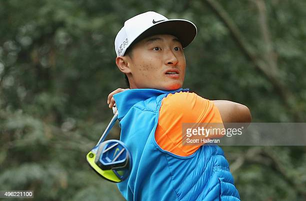 Haotong Li of China hits his tee shot on the 11th hole during the final round of the WGC HSBC Champions at the Sheshan International Golf Club on...