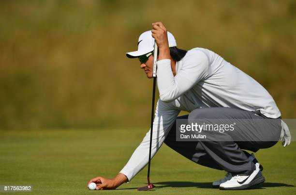 Haotong Li of China lines up a putt on the 8th hole during a practice round prior to the 146th Open Championship at Royal Birkdale on July 18 2017 in...