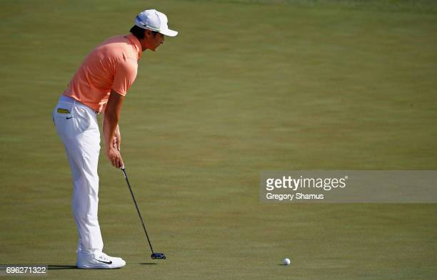 Haotong Li of China lines up a putt on the fifth green during the first round of the 2017 US Open at Erin Hills on June 15 2017 in Hartford Wisconsin