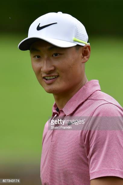 Haotong Li of China looks on during a practice round prior to the 2017 PGA Championship at Quail Hollow Club on August 7 2017 in Charlotte North...