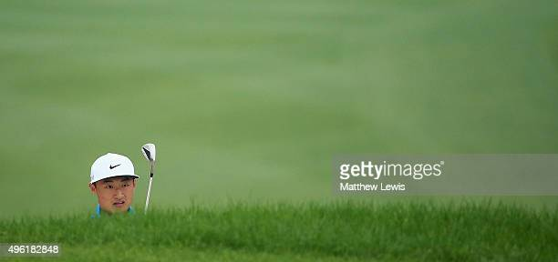 Haotong Li of China looks on during the fourth day of the WGC HSBC Champions at Sheshan International Golf Club on November 8 2015 in Shanghai China