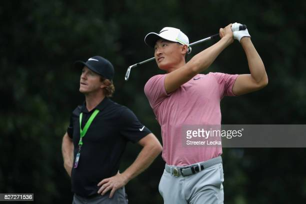 Haotong Li of China plays a shot during a practice round prior to the 2017 PGA Championship at Quail Hollow Club on August 7 2017 in Charlotte North...