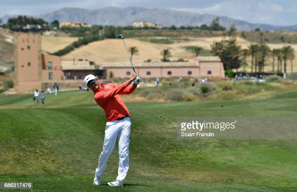 Haotong Li of China plays a shot on the 14th hole during the final round of The Rocco Forte Open at The Verdura Golf and Spa Resort on May 21 2017 in...