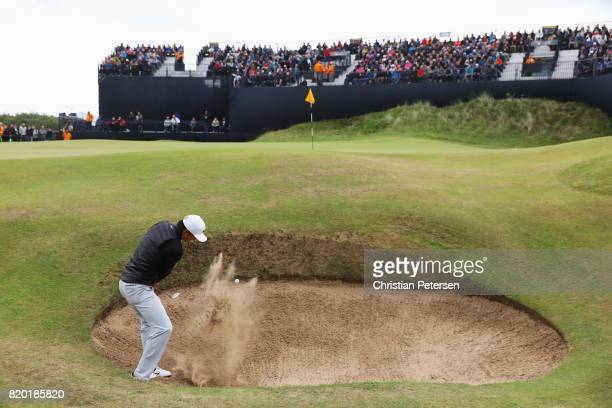 Haotong Li of China plays from a bunker on the 14th hole during the second round of the 146th Open Championship at Royal Birkdale on July 21 2017 in...