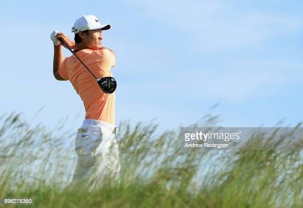 Haotong Li of China plays his shot from the fifth tee during the first round of the 2017 US Open at Erin Hills on June 15 2017 in Hartford Wisconsin
