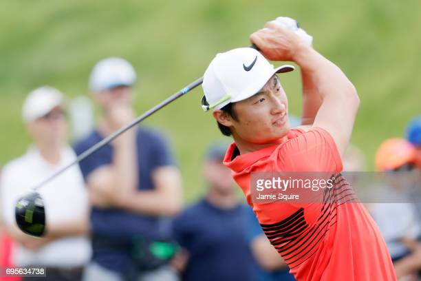 Haotong Li of China plays his shot from the first tee during a practice round prior to the 2017 US Open at Erin Hills on June 13 2017 in Hartford...