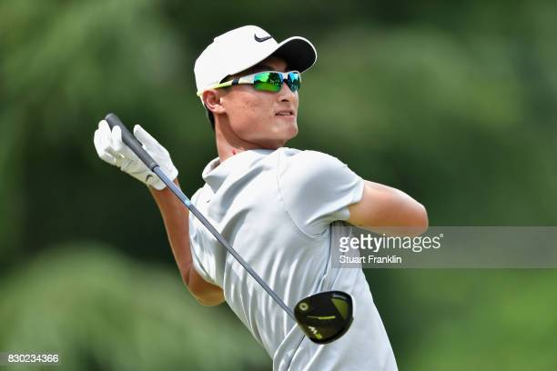 Haotong Li of China plays his shot from the ninth tee during the second round of the 2017 PGA Championship at Quail Hollow Club on August 11 2017 in...