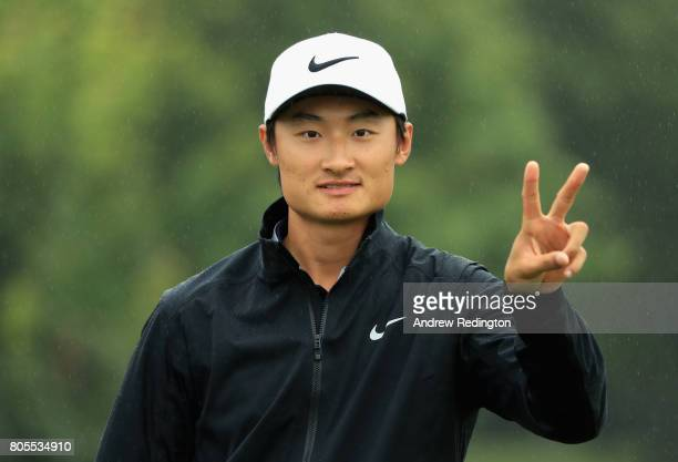 Haotong Li of China poses for a photo as he warms up during day four of the HNA Open de France at Le Golf National on July 2 2017 in Paris France