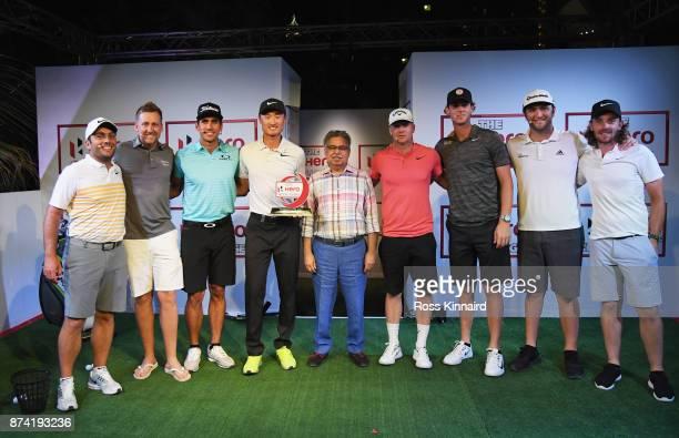Haotong Li of China poses with the winners trophy and Francesco Molinari of Italy Ian Poulter of England Rafa Cabrera Bello of Spain Pawan Munjal...