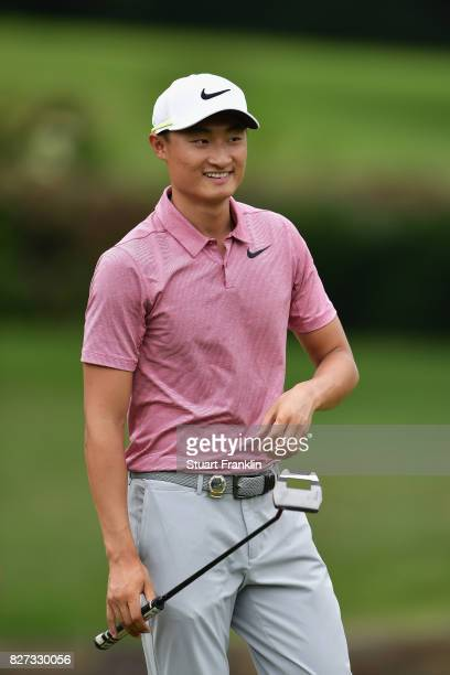 Haotong Li of China reacts during a practice round prior to the 2017 PGA Championship at Quail Hollow Club on August 7 2017 in Charlotte North...