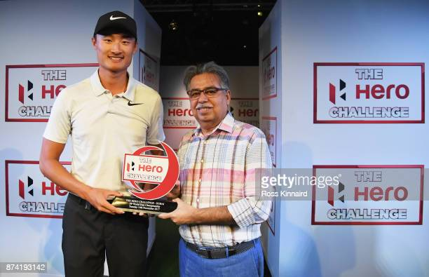 Haotong Li of China receives the winners trophy from Pawan Munjal Chairman Managing Director and CEO of Hero MotoCorp after the Hero Challenge Final...