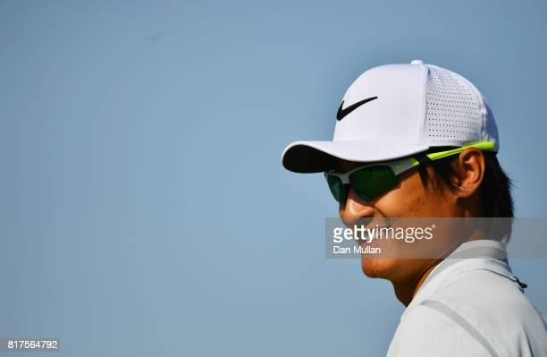 Haotong Li of China smiles during a practice round prior to the 146th Open Championship at Royal Birkdale on July 18 2017 in Southport England