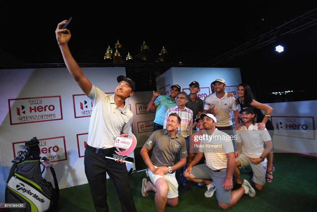 Haotong Li (L) of China takes a selfie with the winners trophy and Francesco Molinari of Italy, Ian Poulter of England, Rafa Cabrera Bello of Spain, Pawan Munjal, Chairman, Managing Director and CEO of Hero MotoCorp, Alex Noren of Sweden, Thomas Pieters of Belgium, Jon Rahm of Spain, Tommy Fleetwood of England, Kirsty Gallacher and Vernon Kay after the Hero Challenge prior to the DP World Tour Championship at Atlantis, The Palm on November 14, 2017 in Dubai, United Arab Emirates.