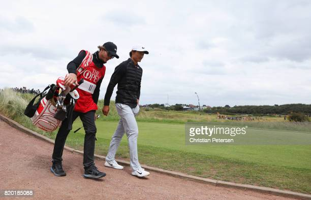 Haotong Li of China walks on on the 14th hole with his caddie during the second round of the 146th Open Championship at Royal Birkdale on July 21...
