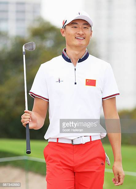 Haotong Li of China walks to a green during a practice round during Day 3 of the Rio 2016 Olympic Games at Olympic Golf Course on August 8 2016 in...