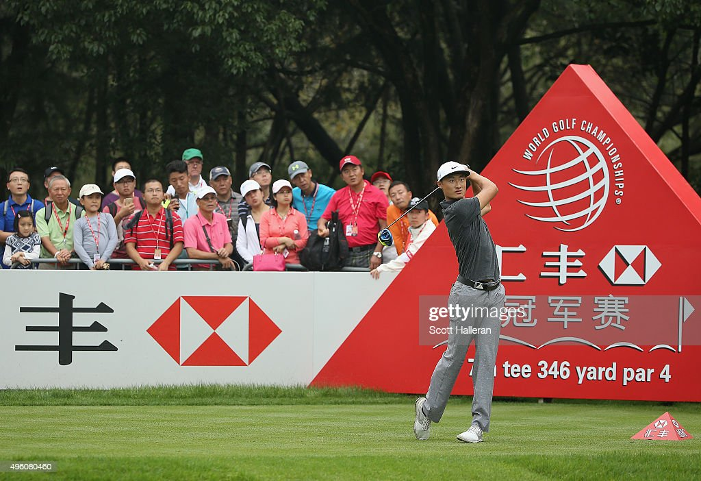 Haotong Li of China watches his tee shot on the seventh hole during the third round of the WGC HSBC Champions at the Sheshan International Golf Club...