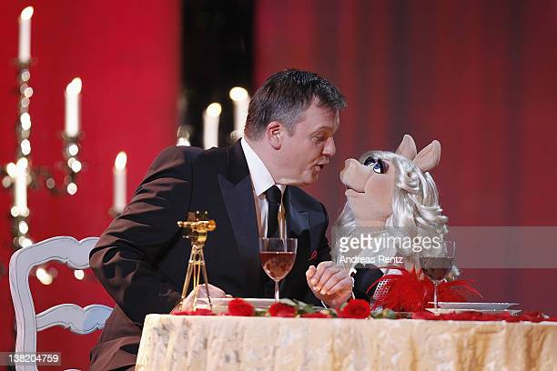 Hape Kerkeling and Miss Piggy seen on stage at the 47th Golden Camera Awards at the Axel Springer Haus on February 4 2012 in Berlin Germany