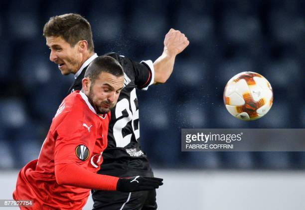Hapoel Beer Sheva's forward from Israel Ben Sahar fights for the ball with Lugano's Swiss defender Fulvio Sulmoni during the UEFA Europa League Group...