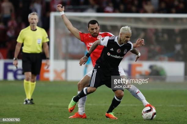 Hapoel Beersheba's Israeli defender Shir Tzedek tackles Besiktas's Portuguese midfielder Ricardo Quaresma during the UEFA Europa League football...